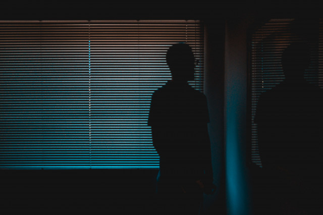 B2ap3 Medium Man Behind Blinds Unsplash