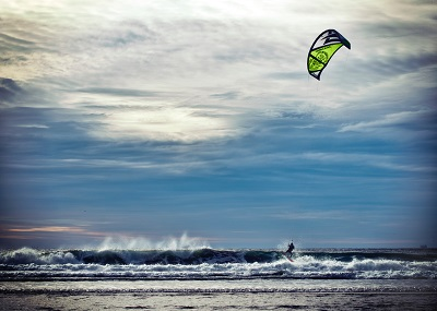 A person kitesurfing on the ocean
